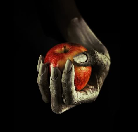 poisoned-apple-in-hand-tattoo-design